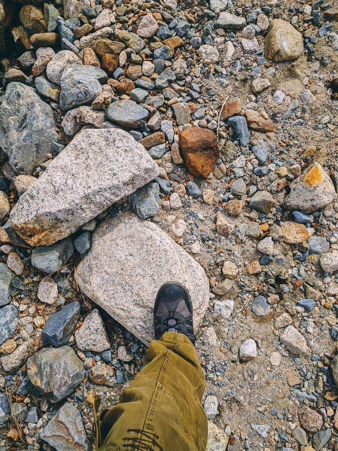Feet trekking boots hiking Traveler alone. stock photos