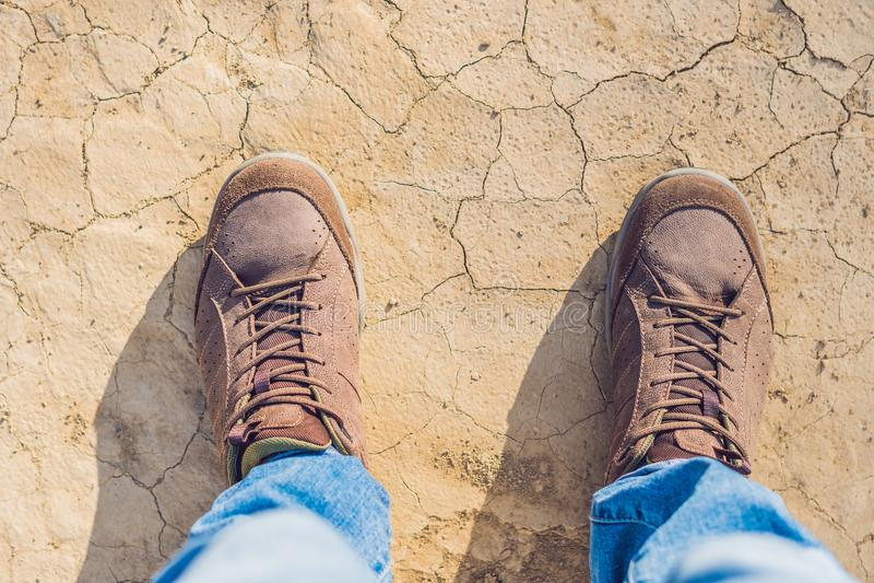 Feet trekking boots hiking Traveler alone outdoor wild nature Li royalty free stock photography