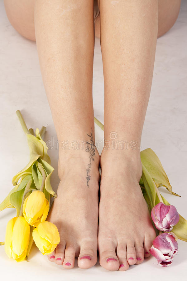 Feet and tulips royalty free stock photos