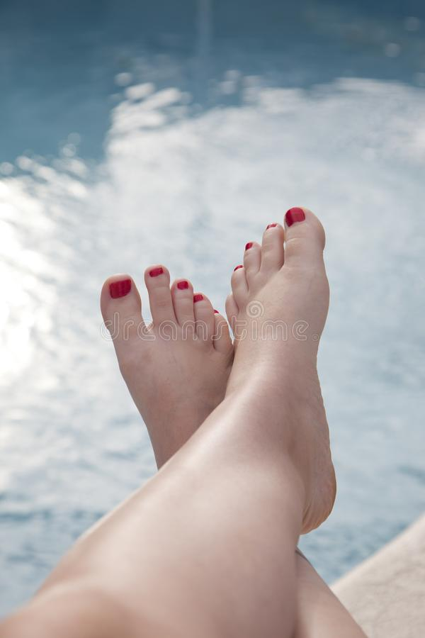 Feet up by the pool stock image