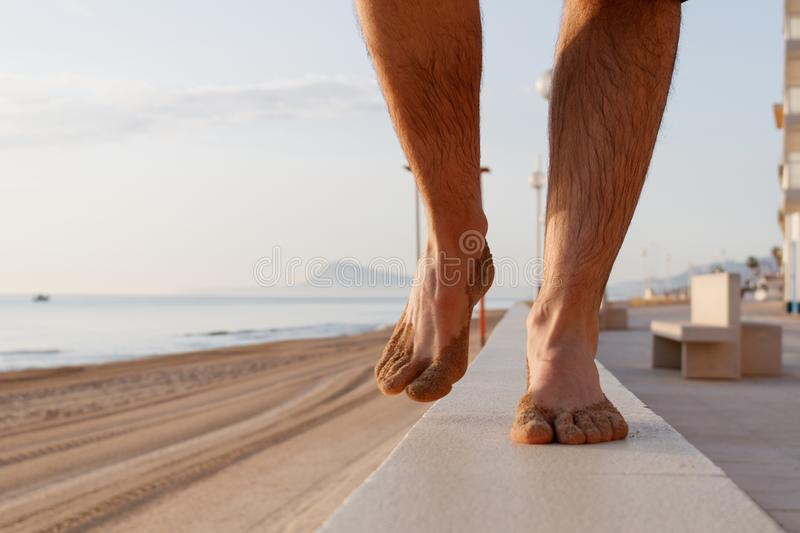 Feet walking on the beach royalty free stock photography
