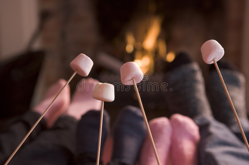 Download Feet Warming At A Fireplace With Marshmallows Stock Image - Image: 5938181