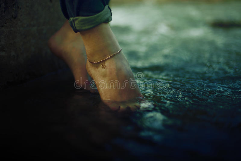 Feet in Water royalty free stock photography
