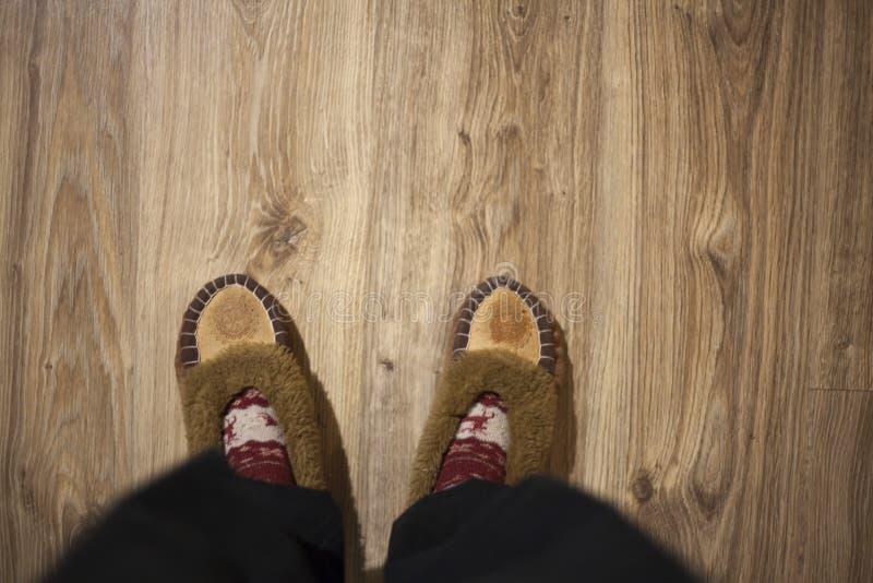 Feet wearing Christmas socks on wood floor. Happy family at home. Xmas holidays concept. Feet wearing Christmas socks on wood floor. Happy family at home stock photos
