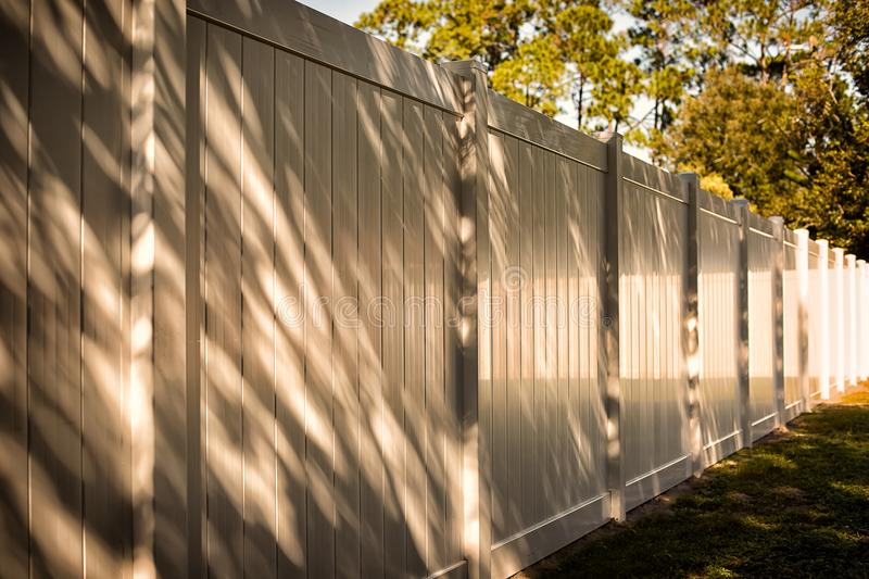 Solid Privacy Vinyl Fence. 6 feet White Solid Privacy Vinyl Fence around your house royalty free stock image