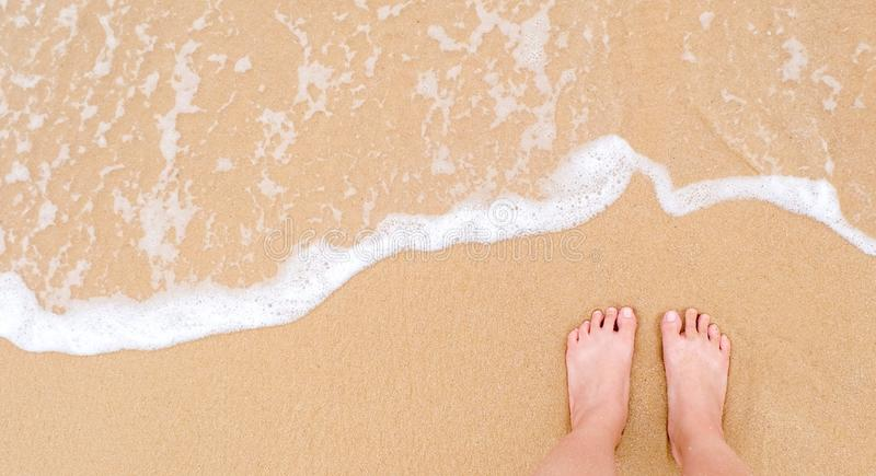 Feet of a woman on sandy beach. At Phayam island, vintage island stock photography