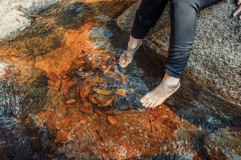 Feet women in waterfall ,relax Travel concept in the forest royalty free stock photos