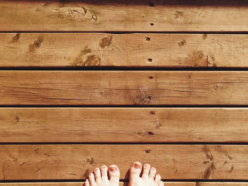 Feet on Wood. En planks in my parents garden royalty free stock photography