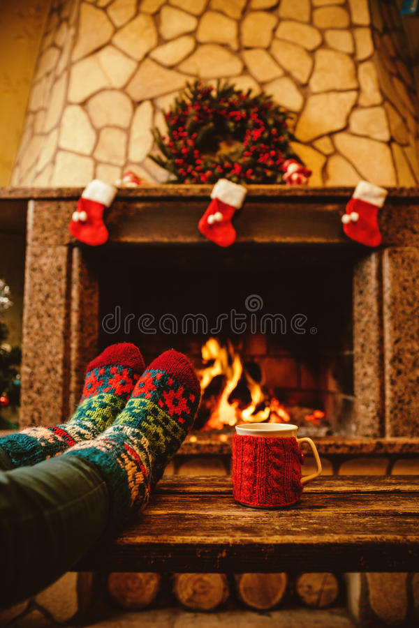 Feet In Woollen Socks By The Christmas Fireplace Woman