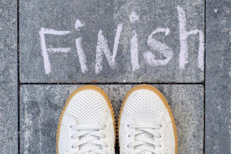 Feet before the word finish. The symbol is drawn in chalk stock photos