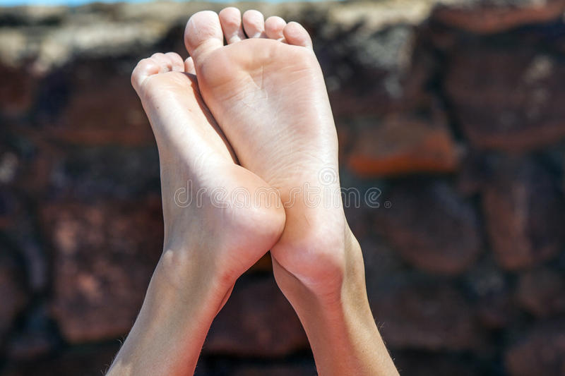 Feet of young boy royalty free stock photography