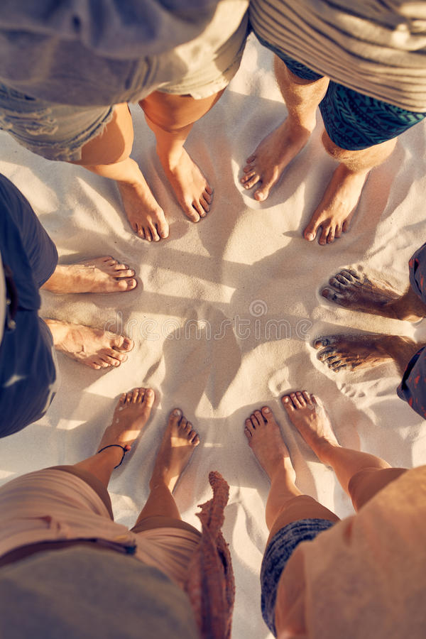 Feet of young people standing in a circle stock photo