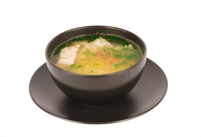 Feg soppa i den isolerade svarta bunken royaltyfri bild