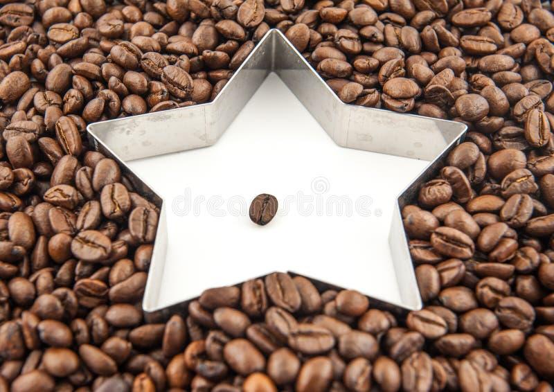 Feijões de café da estrela foto de stock royalty free