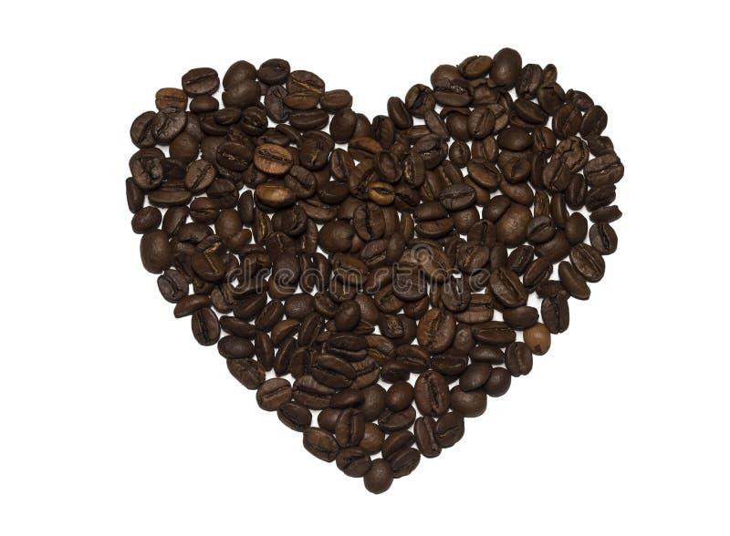 Feijões de café dados fôrma coração fotos de stock