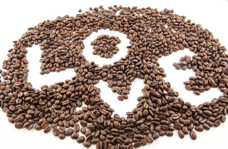 Feijões de café do amor foto de stock