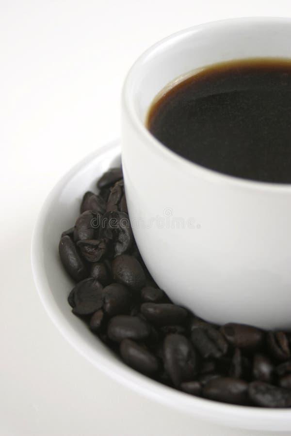 Feijões de café e café fotografia de stock