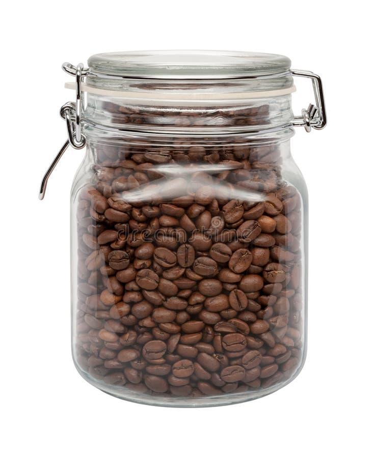 Feijões de café em um cartucho de vidro imagem de stock