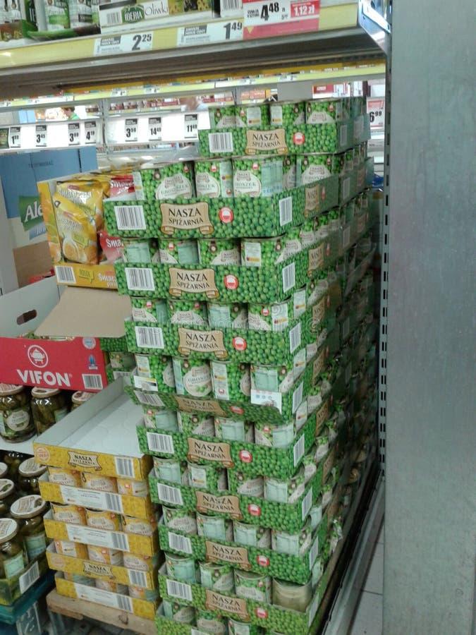 Feijões em umas latas fotos de stock
