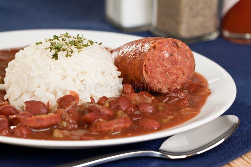 Feijões vermelhos e arroz com salsicha fotografia de stock royalty free