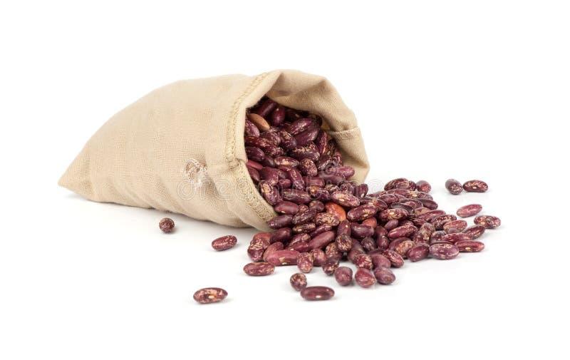 Feijões vermelhos secados no saco da lona imagens de stock royalty free