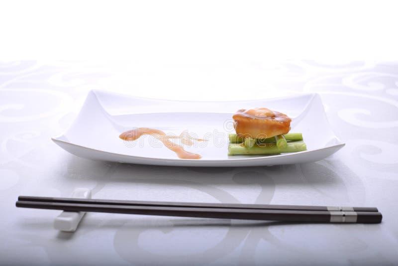 Feines Speisen der Ohrschnecke in einem Restaurant, in dem Darstellung wichtig ist stockbild