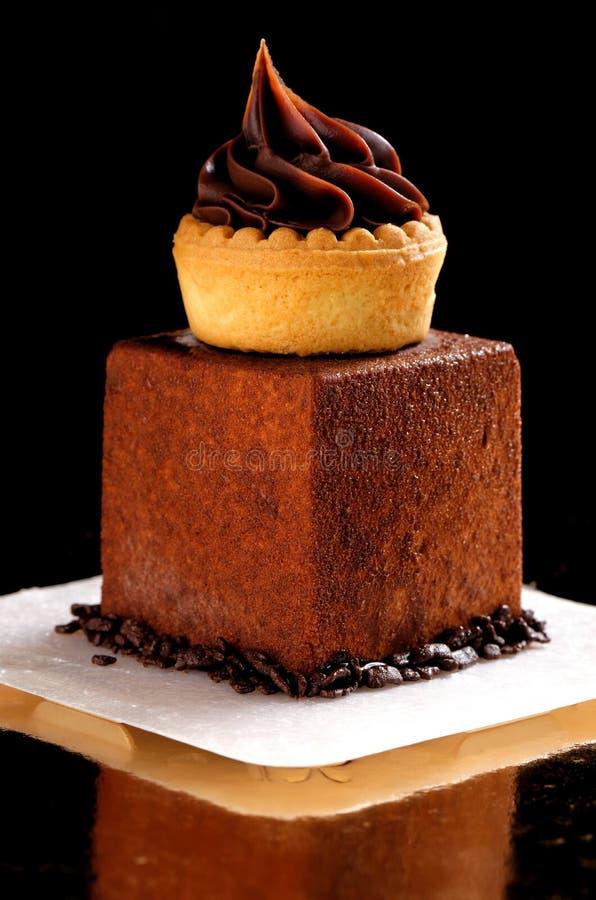 Feines Speisen, französischer dunkler Schokoladenfeinschmecker Mignon stockbild