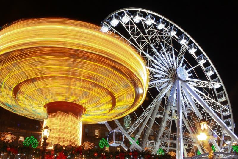 A feira no movimento seis e na roda grande fotografia de stock