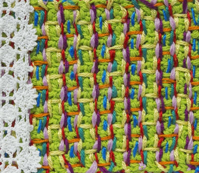Feito a mão brilhante faz crochê o teste padrão, fazendo malha, costurando Fundo colorido do ponto caseiro, bordado Contexto para imagem de stock royalty free