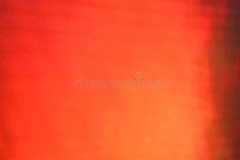 Feixe luminoso da textura alaranjada do fundo do sumário do inclinação fotos de stock royalty free