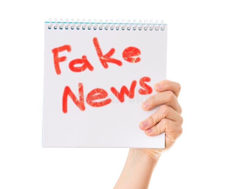 Fejka nyheternabegreppet fotografering för bildbyråer