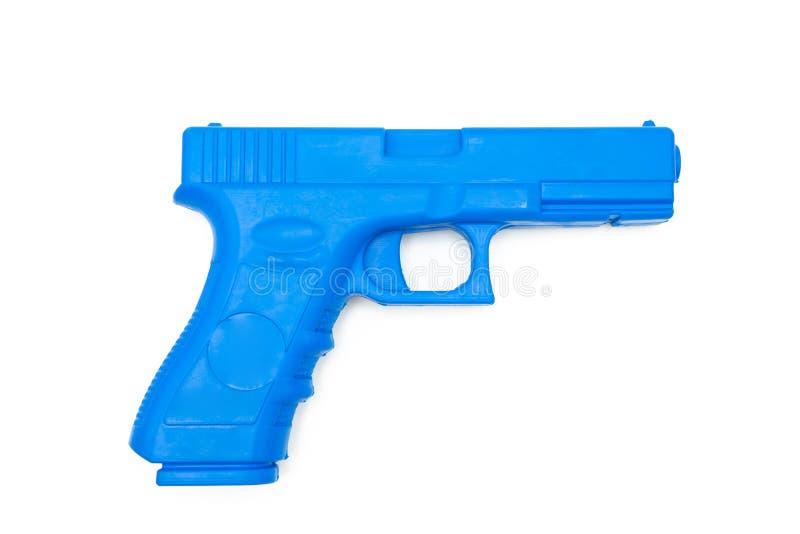 Fejka vapen gjorde från gummi för utbildningen av polisen, soldater och säkerhetspersonal Shape och vikt som ett verkligt vapen v royaltyfri foto