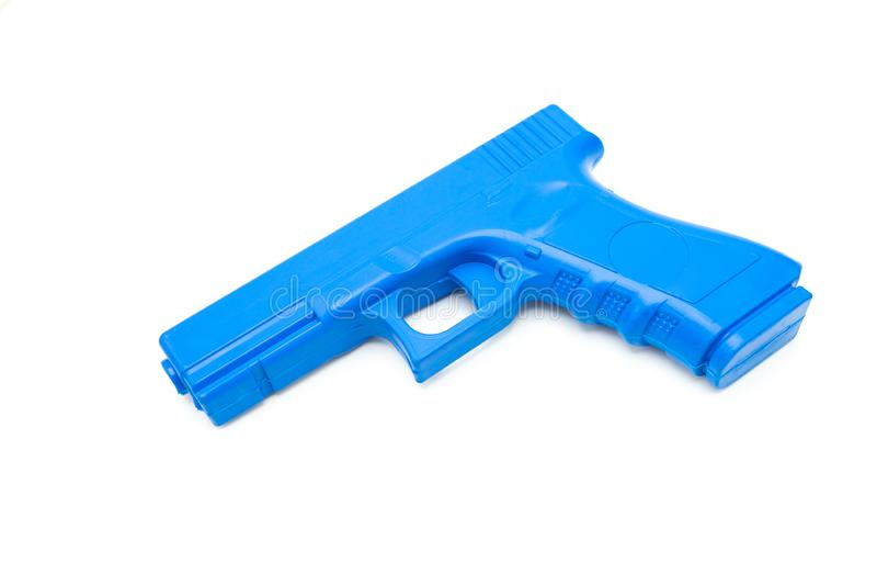 Fejka vapen gjorde från gummi för utbildningen av polisen, soldater och säkerhetspersonal Shape och vikt som ett verkligt vapen v arkivbild
