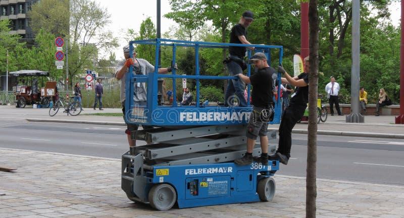 Felbermayr scissor platform. VIENNA, AUSTRIA - CIRCA APRIL 2016: Felbermayr scissor platform with operators stock image