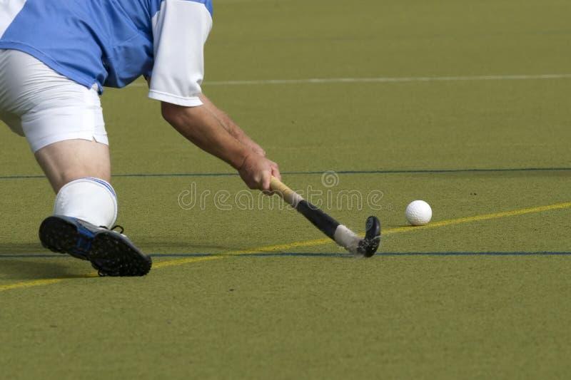Feld-Hockey-Spieler stockfotos