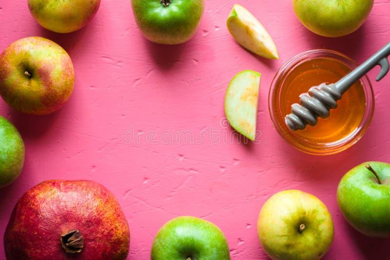 Feld von Äpfeln, von Granatapfel und von Honig für das Rosh Hashanah stockfoto