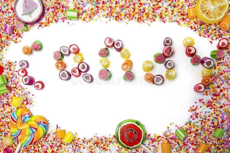 Feld von Süßigkeiten mit Süßigkeitswort lizenzfreie stockbilder