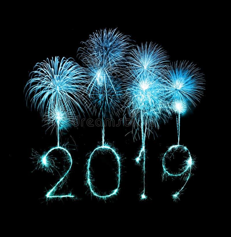 2019 Felices Año Nuevo con el fuego artificial de la chispa foto de archivo libre de regalías