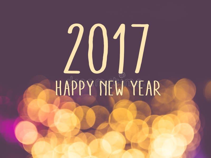 2017 Felices Año Nuevo en backgrou festivo de la luz del bokeh de la falta de definición del vintage imagen de archivo