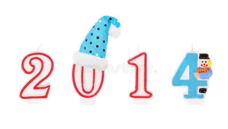 Felices Año Nuevo 2014 por los candkes. imagenes de archivo