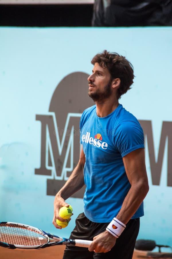 Feliciano Lopez que joga o tênis fotografia de stock