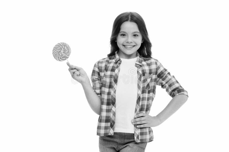 Felicidad dulce Piruleta dulce sonriente del control de la cara de la muchacha Muchacha como fondo blanco aislado caramelo de la  foto de archivo