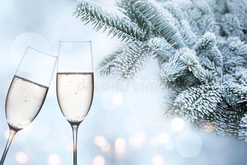 Felicitações invernal com champanhe fotografia de stock