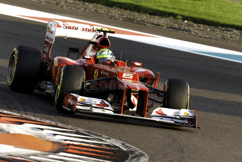 Felipe Massa cornering a Ferrari F1 car at Yas Marina race track Abu Dhabi. 2012 F1 Gran Prix stock photography