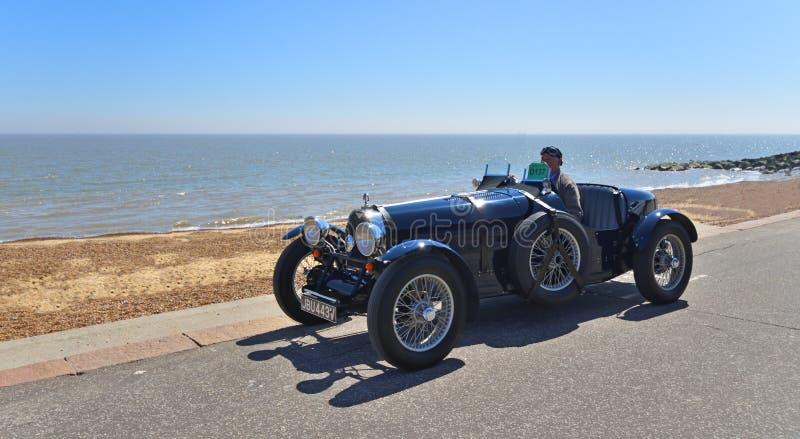Classic Blue Bugatti Racing Car being driven along Seafront Promenade. stock photos