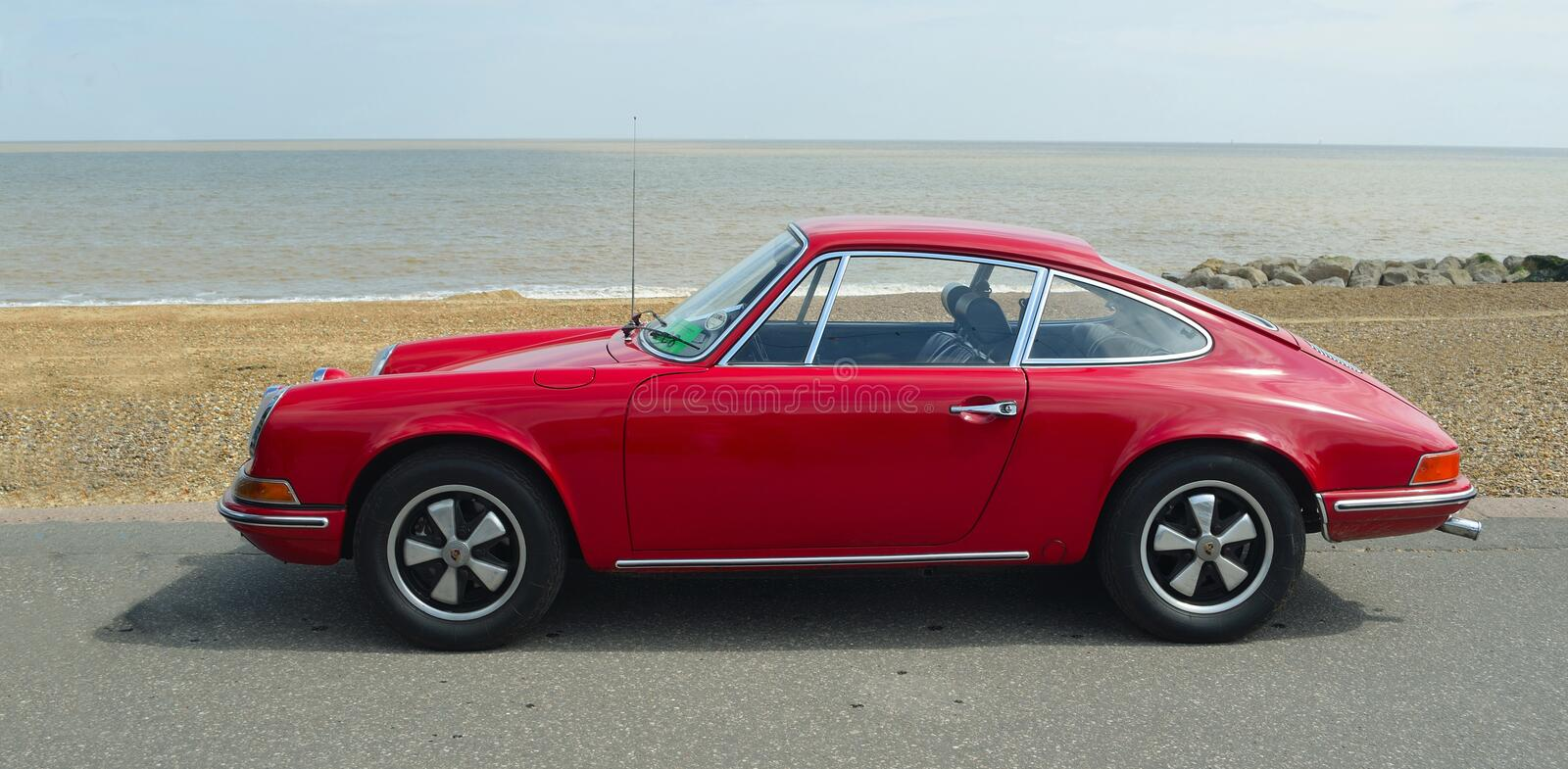 Classic Red Porsche 912 parked on seafront promenade. royalty free stock image