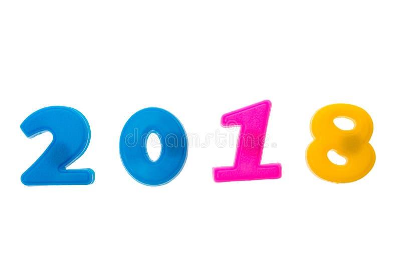 Feliz Año Nuevo 2018 de las figuras coloridas reales números del imán aislados en blanco foto de archivo