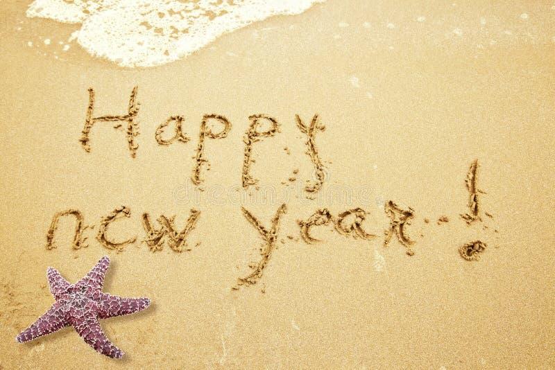 Feliz Año Nuevo en la arena imagen de archivo