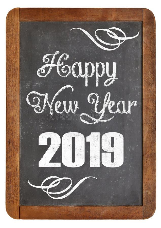 Feliz Año Nuevo 2019 en la pizarra foto de archivo