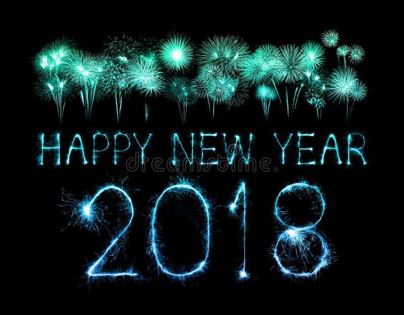 Feliz Año Nuevo 2018 escrita con el fuego artificial de la chispa imagen de archivo